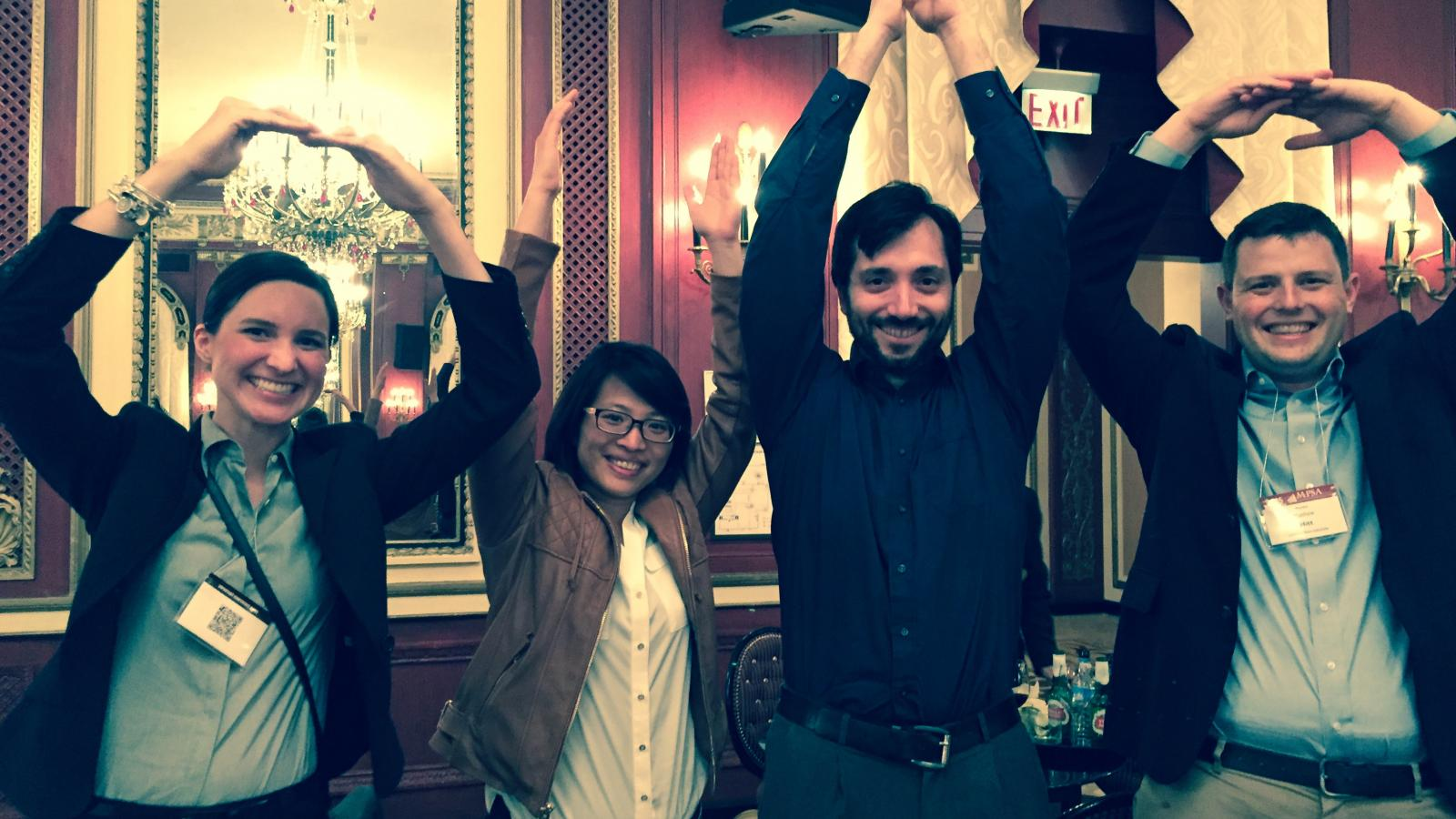 Graduate Students at MPSA Conference doing O-H-I-O